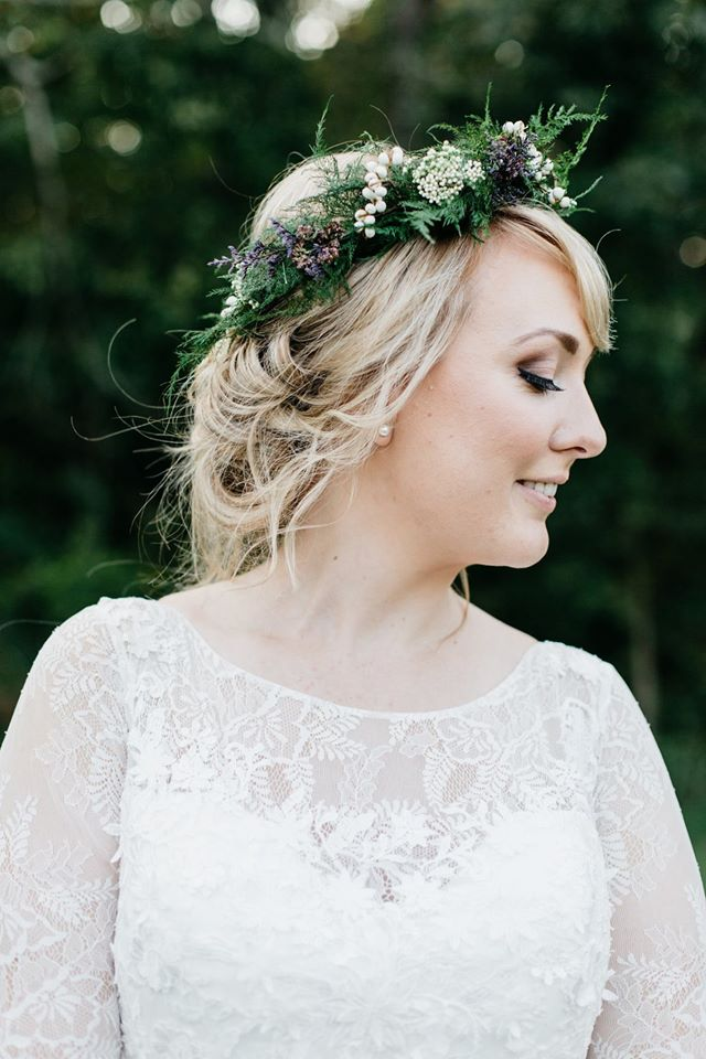 gorgeous bride with a lace gown and a floral crown