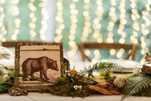 woodland themed wedding centerpiece with a bear