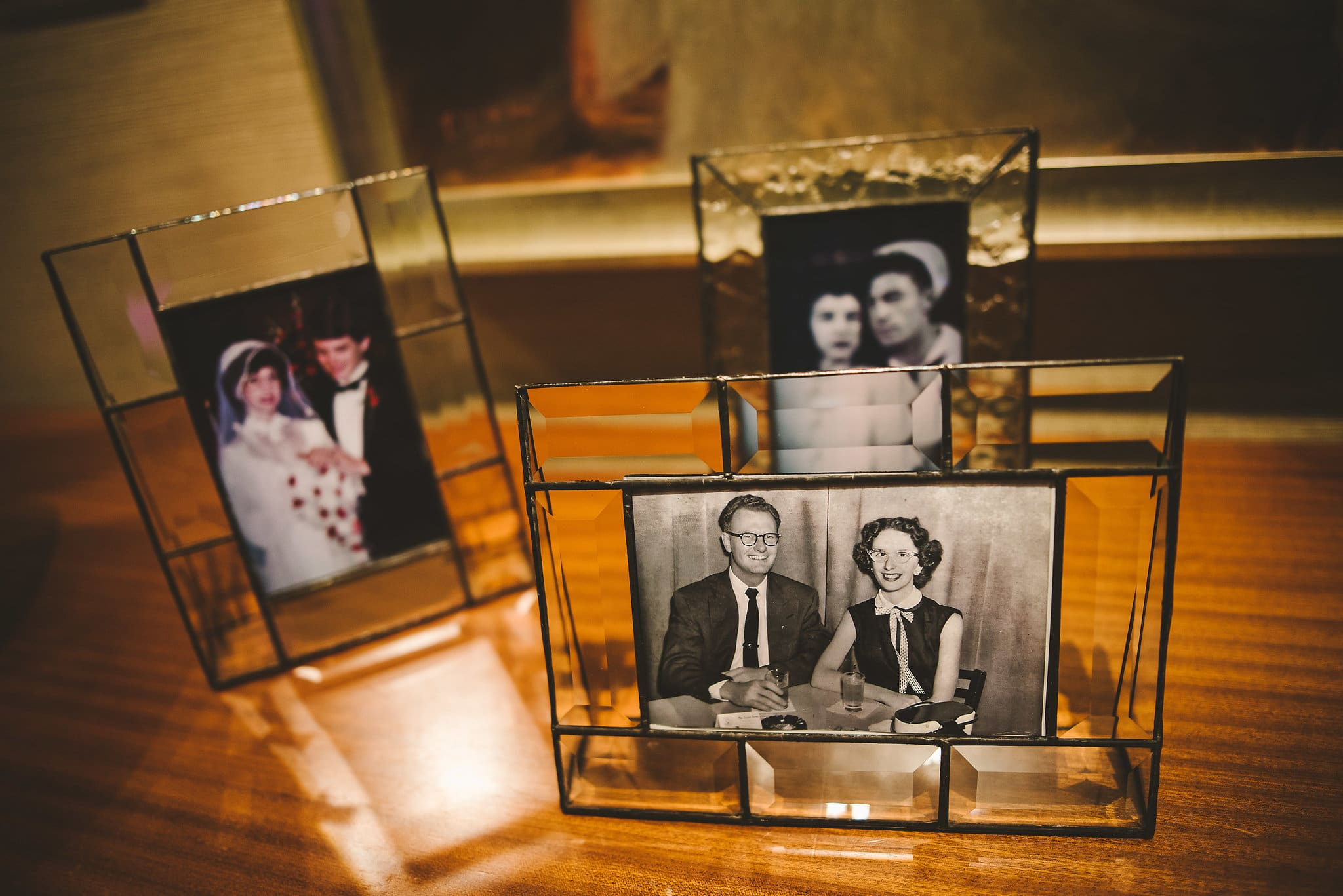 family photos set out at a wedding welcome table