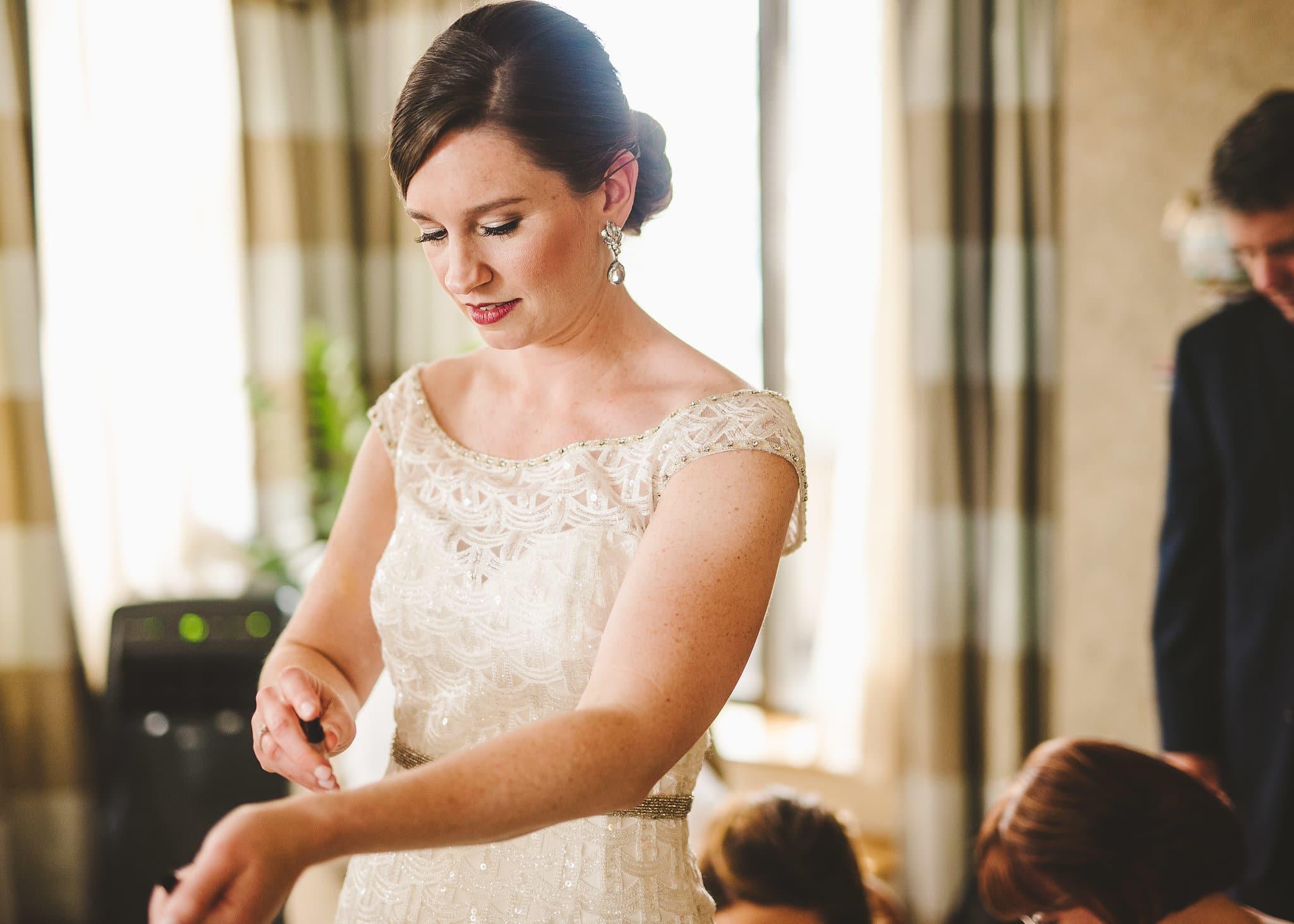 Bride spraying on her wedding perfume