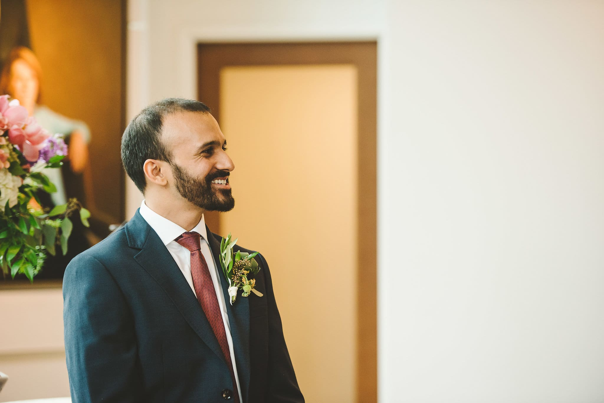 groom seeing his bride for the first time walking down the aisle