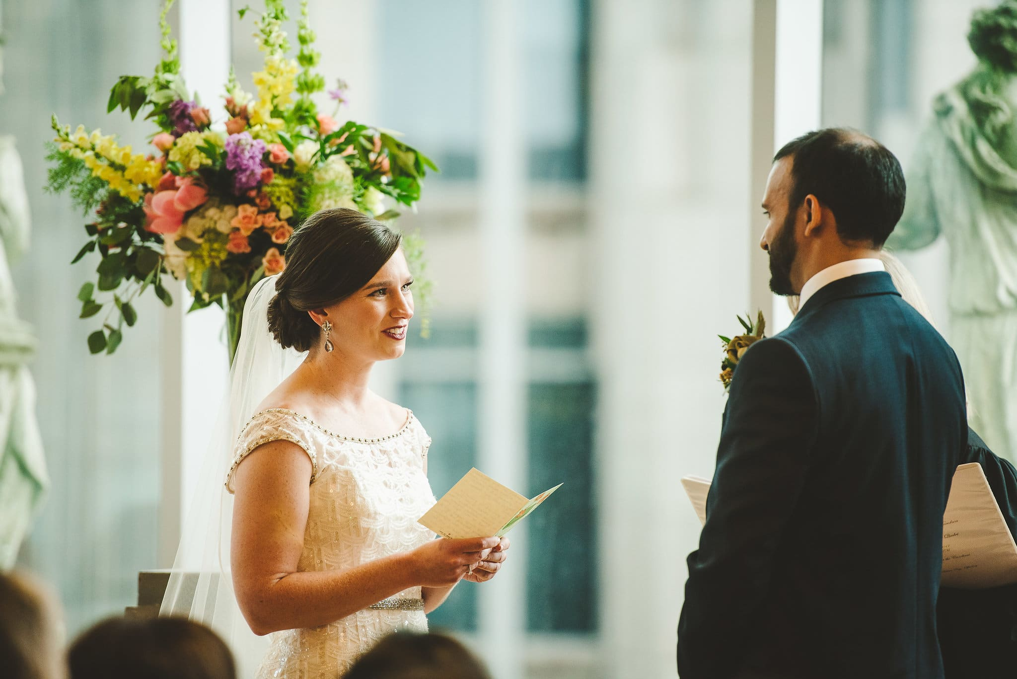 exchanging vows during a Wedding ceremony at Foundation for the Carolinas in uptown Charlotte, NC