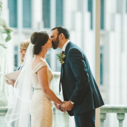 first kiss at a Wedding ceremony at Foundation for the Carolinas in uptown Charlotte, NC