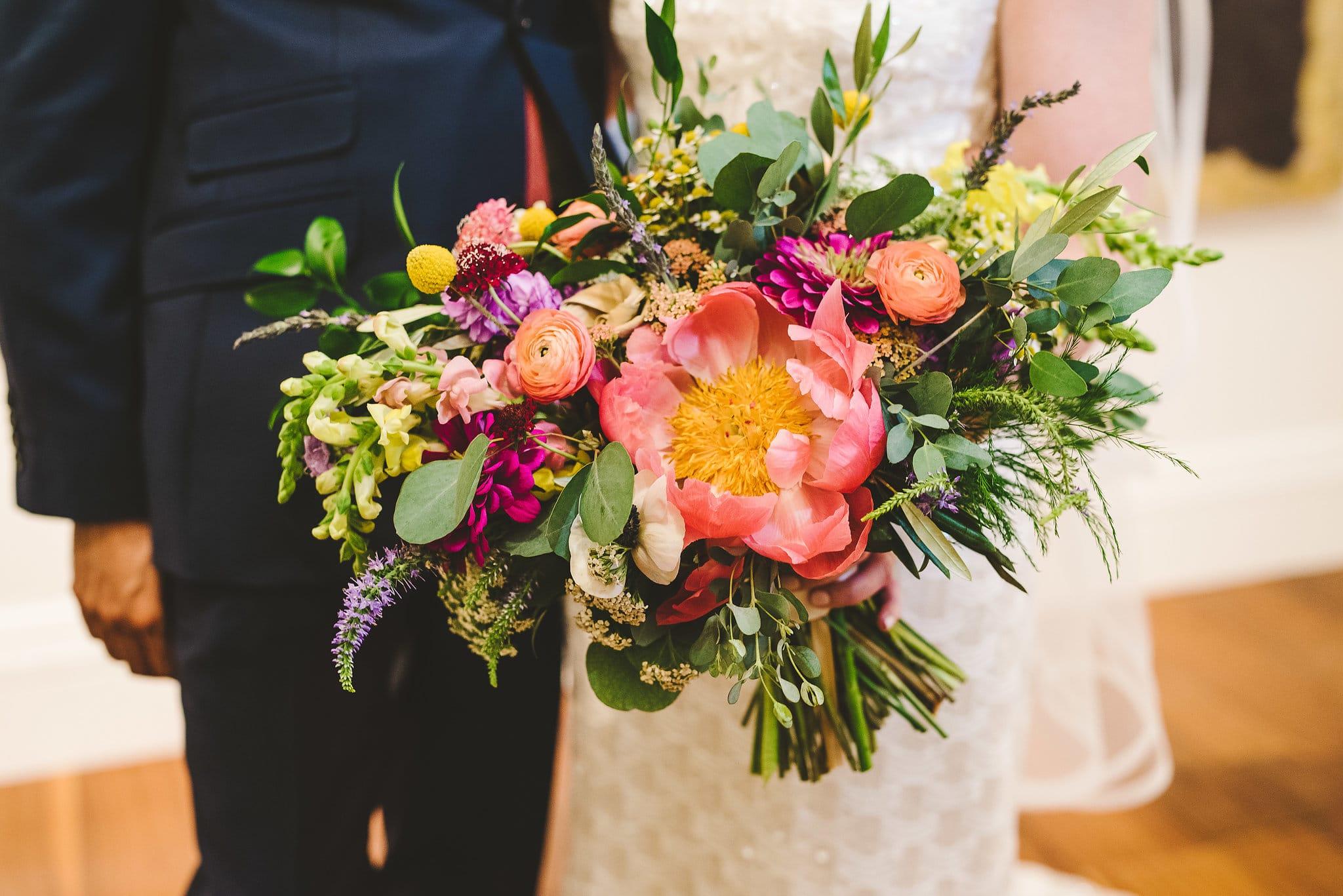 Gorgeous bridal bouquet with peonies, ranunculus, dahlias, eucalyptus, mint leaves