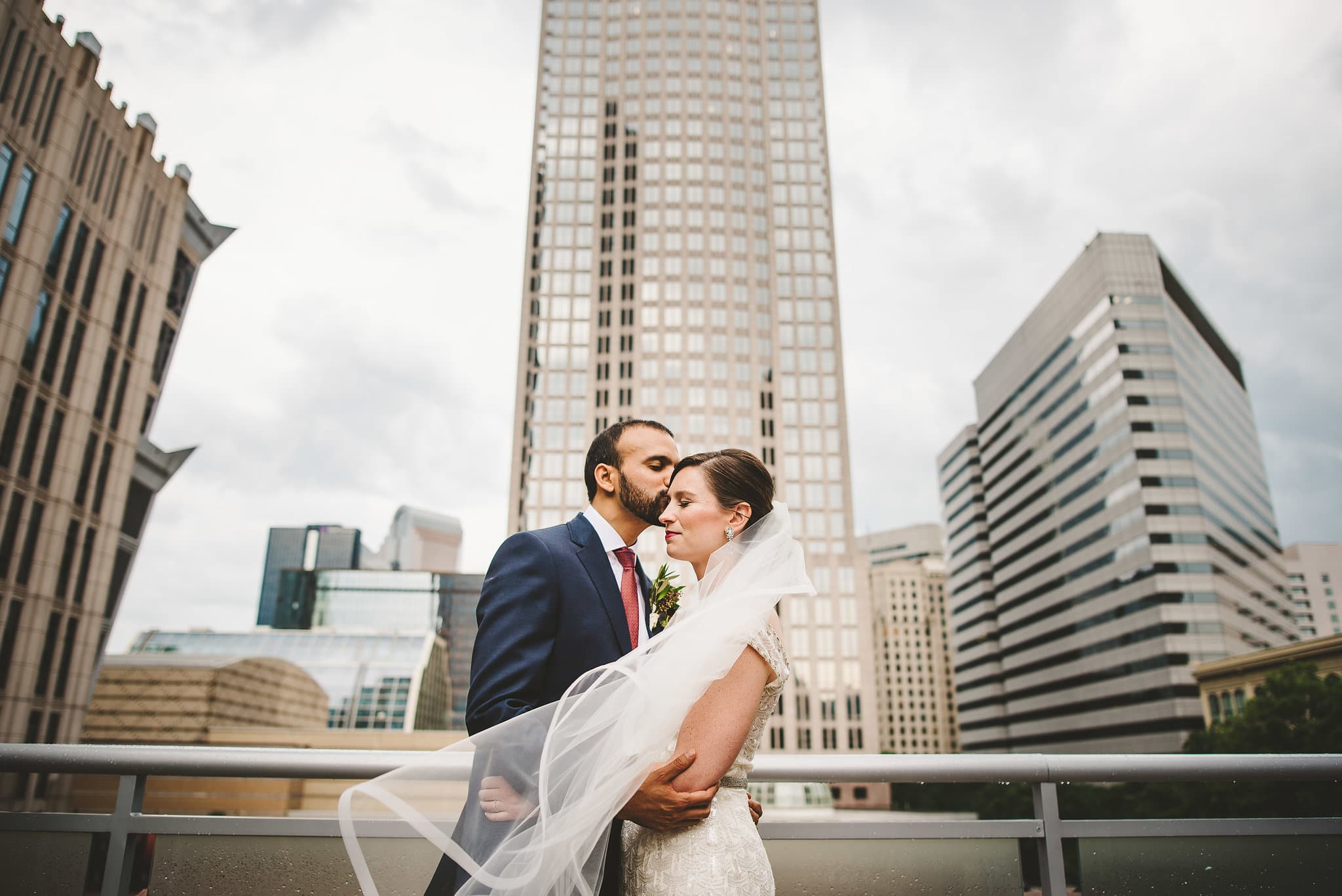 bride and groom photos with uptown charlotte as the backdrop