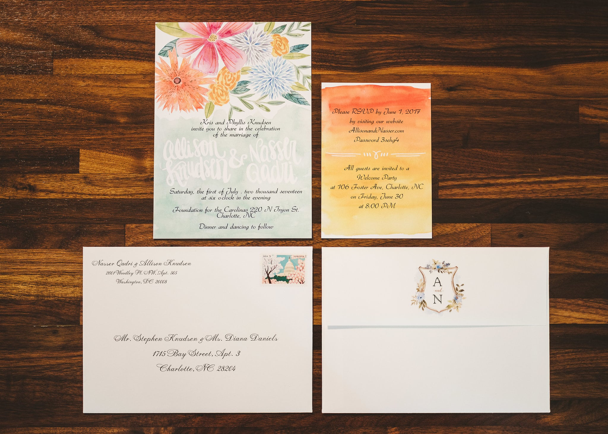 wedding invitations with water color flowers and floral crest